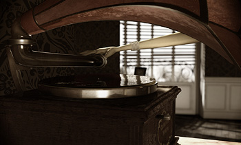 Elba's hand plays tango record on phonograph